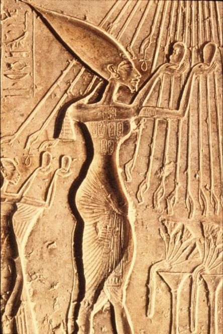 Akhenaten worshiping the Sun.