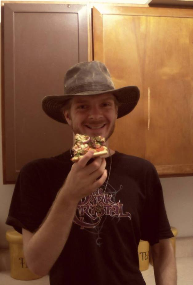 A photo of me enjoying a delicious vegan pizza from Pizza Fusion. The pizza was an early birthday gift from my best friend and fellow Coloradan. Photo taken September 12, 2013.