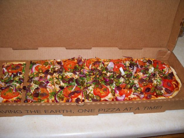 An extra large vegan Greek pizza with roasted tomatoes, red onions, jalapenos, kalamata olives, and parsley. Absolutely delicious!