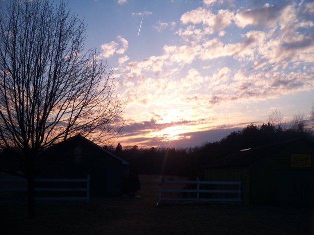 The sun sets behind Gail's art studio in Michigan. Photo taken from the porch of her house on April 4, 2013.