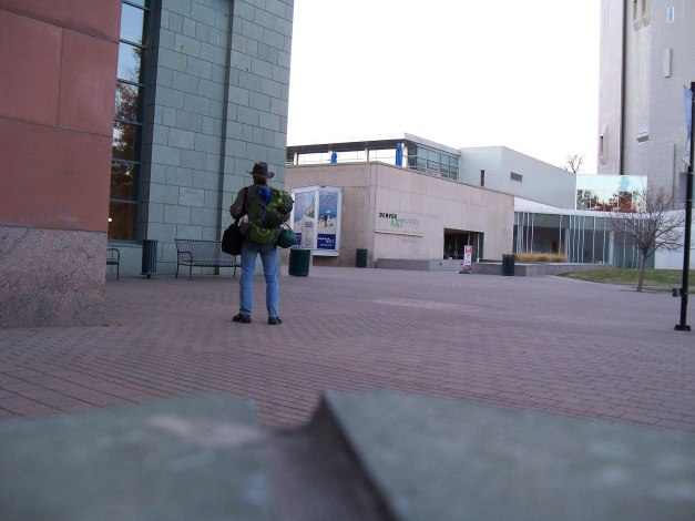 Me standing at the Denver Public Library with my hiking backpack, shoulder bag, and laundry bag, which weighed over 90 lbs. Photo taken November 2, 2013.