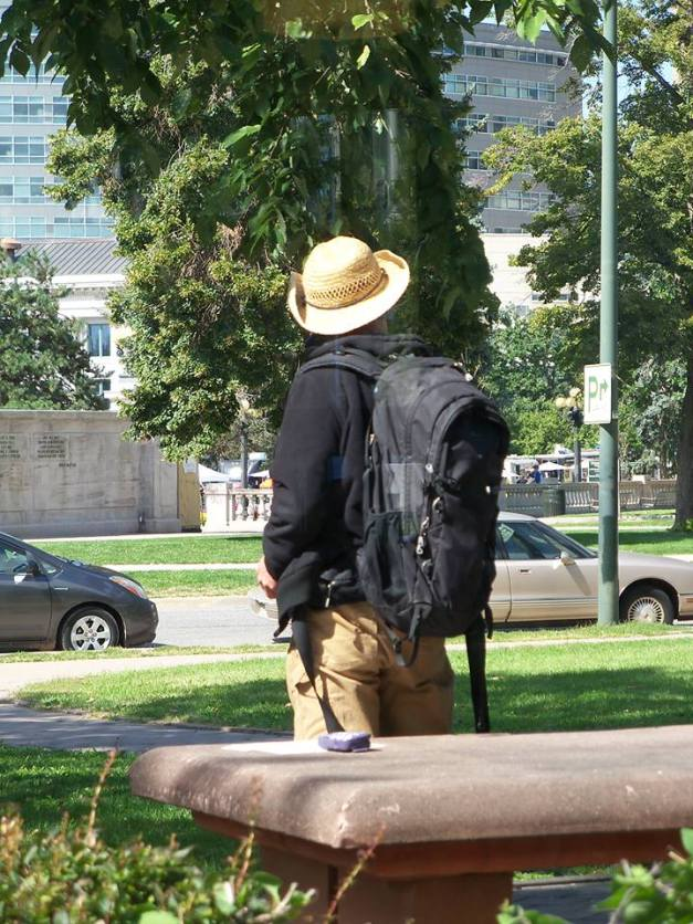 An indigent traveller stopping by outside the library to access the wi-fi. Photo taken September 19, 2013.