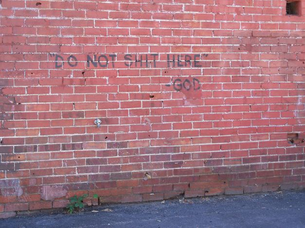 Semi-humourous graffiti outside of a church-run shelter. Where one relieves oneself is a very serious challenge when you are homeless. Photo taken September 2, 2013.