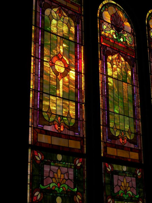 The beautiful stained glass windows of St. Paul's refracting the light of the setting sun. Photo taken October 27, 2013.