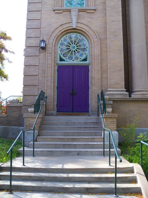 The welcoming purple door to Saint Paul United Methodist & Inter-Spiritual Community on 1615 Ogden St., Denver. Photo taken October 14, 2013.