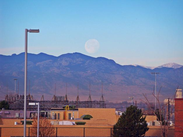 The moon looking quite giant over the Colorado Rockies. Photo taken on December 19, 2013, two days after the full moon.