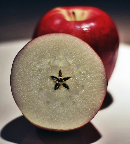 The five-pointed star found at the center of an apple when it is cut in half.