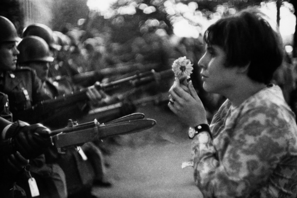 """La Jeune Fille a la Fleur"", or ""The Girl with the Flower"" by Marc Riboud (1967)."